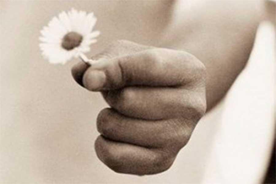 Child holding white flower
