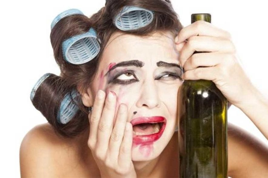 Girl looking stressed with wine bottle