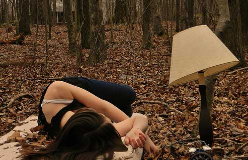 Girl laying down in woods