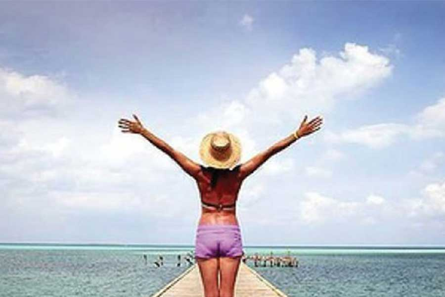 Girl on dock with arms raised