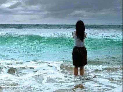 Girl staring out to sea