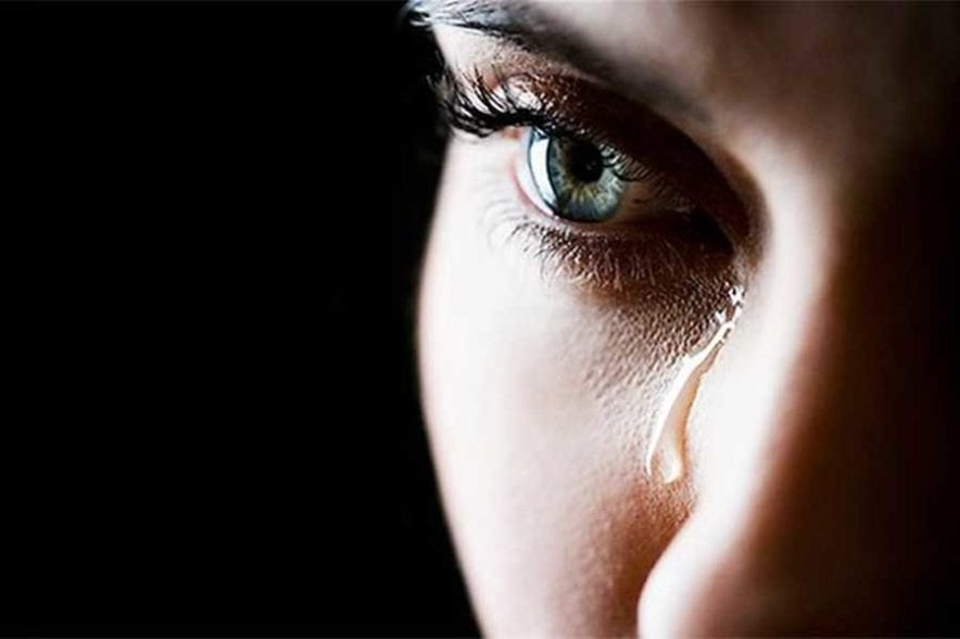 Girl with tear running down face